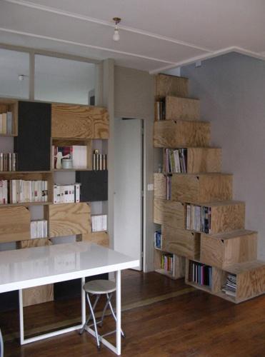 Rénovation et réorganisation d'un appartement classique : living-coin repas